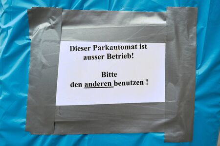 Sign with the inscription: this parking automat is out of order! Please use the other one. Stock Photo