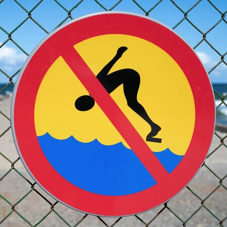 Prohibition sign at the dilapidated pier near Niechorze on the Polish Baltic coast Stock Photo