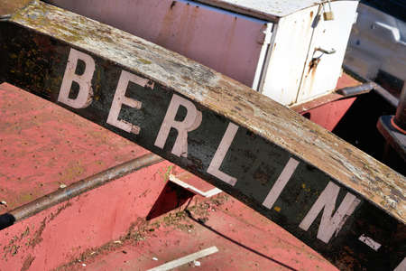 Marking the home port of a ship with the lettering Berlin. The decommissioned barge is located on the Fischerinsel in Berlin. Foto de archivo