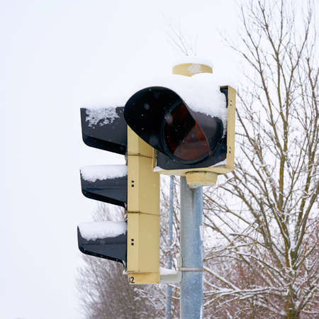 Traffic lights at an intersection in Magdeburg in Germany in winter