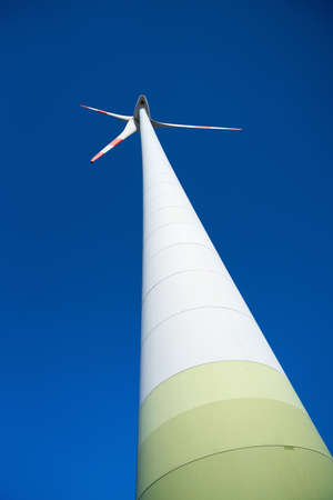 View of a wind turbine in the north of the city of Magdeburg seen from below