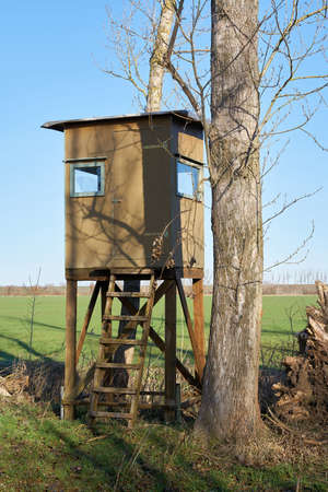 High seat of a hunter at the edge of a field near Magdeburg in Germany Editorial