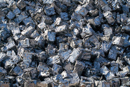 cubes of pressed scrap at a scrap yard in the harbor in Magdeburg in Germany