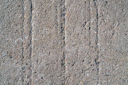 Grooves in a wall of concrete on a structure made of concrete Standard-Bild