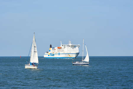 Swinoujscie, Poland - September 12, 2020: The ferry Robin Hood and sailboats on their way to the port of Swinoujscie on the Polish Baltic coast Editorial