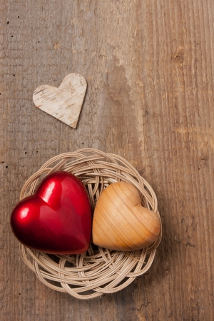 dear: Hearts in a basket on a wooden table Stock Photo