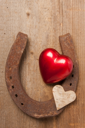 dear: Red heart and a horseshoe on a wooden board