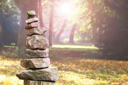 Stacked stone pyramid from sandstone in an autumnal park