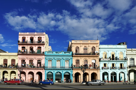 old people: Havana street scene with people, colorful buildings and old cars Editorial