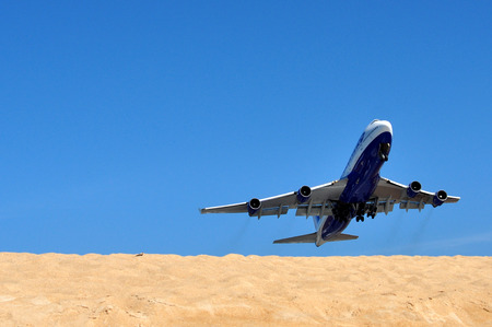 takeoff: aircraft takeoff on the beach