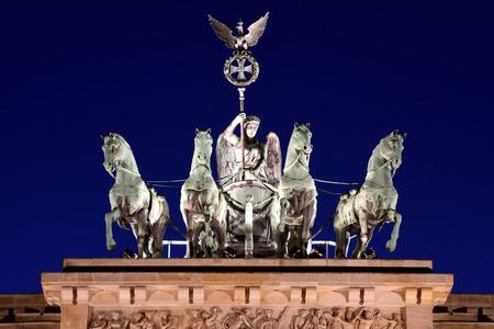 quadriga: detail shot of the Quadriga on top of the Brandenburg Gate in Berlin, Germany during sunset