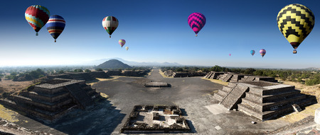 panoramic view of the ruins of Teotihuacan with colorfull balloons in a sub valley of Mexico - The Avenue of the Dead and the pyramid of the sun seen from the pyramid of the moon
