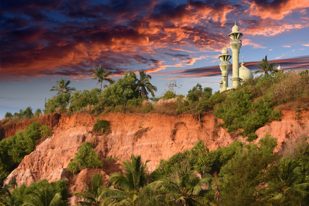 varkala: Mosque on top of red colored stones cliff in Varkala, Kerala, India