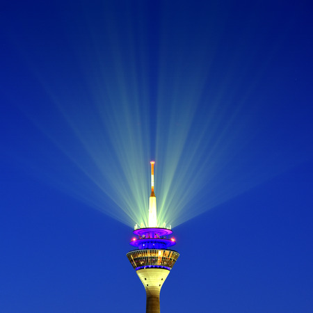Close up view of Duesseldorf tower, Germany with rhinestown and laser beam Фото со стока