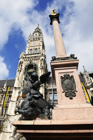 Golden sculpture of St Mary with the city town hall, Munich, Germany