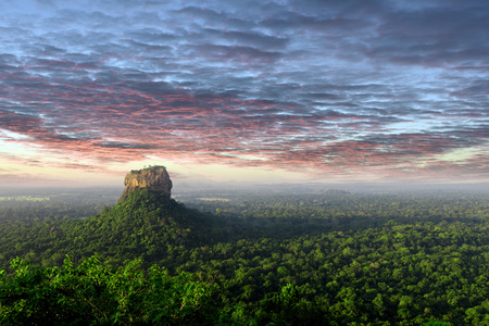 panorama Sunrise view of Sigiriya rock - Lion Rock - from Pidurangala rock in Sri Lanka