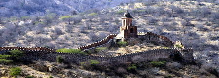 ancient watchtower in the great indian wall overlooking the city of Amer near the Amber Fort, Radjasthan, Jaipur, India