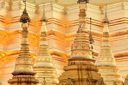 Detail view to a group of golden stupas at the Shwedagon Pagoda in Yangoon, Myanmar (Burma)