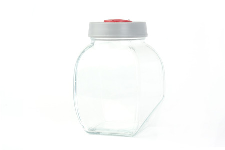 Empty glass jar over white background photo