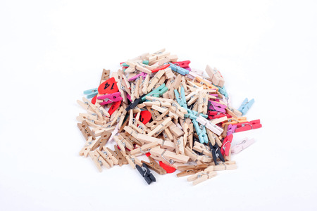 Colorful wood pegs pins on white background photo