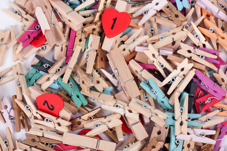 Closeup of colorful wood pegs pins photo