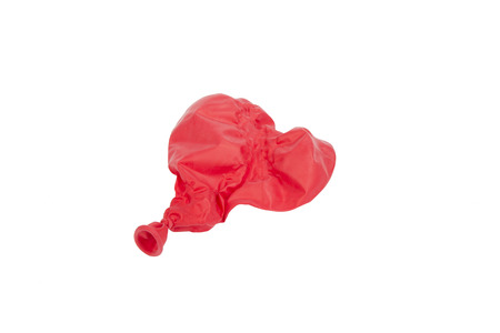 popped: Popped red heart shaped balloon isolated on white