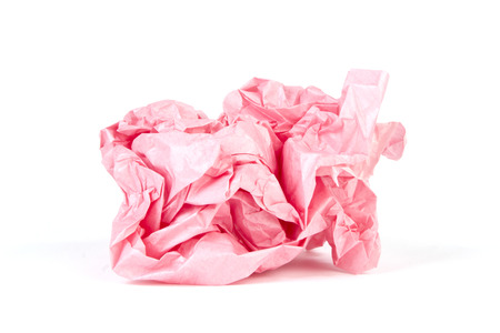 creasy: Crumpled wrapping paper in a ball on white