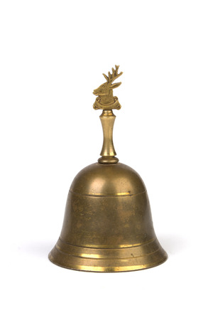 clang: Antique brass hand bell on white