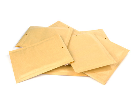 padding: Pile different size bubble lined shipping or packing envelopes Stock Photo