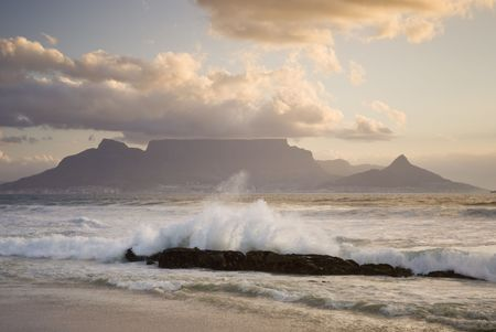 Table mountain with wave crashing in foreground