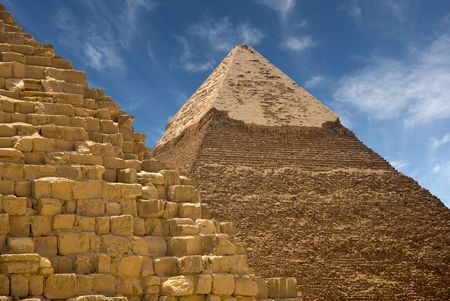 Base of a pyramid in the foreground with another pyramid in the background on a sunny day photo