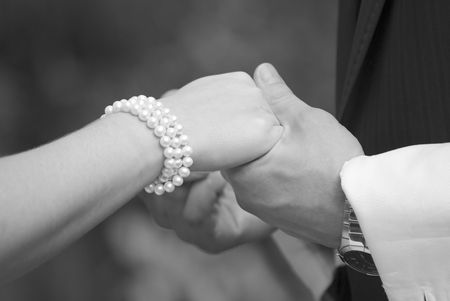 Close up of wedding couple holding hands. Photo in black and white Stock Photo