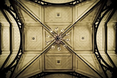Ceiling of an old church, showing symmetric details. Sepia tones