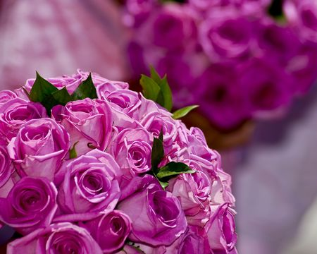 Two pink rose wedding flower bouquets.