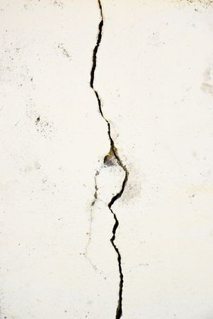 Pronounced crack in a wall running vertically with extra textures Stock Photo - 6232150