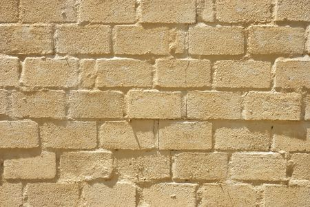 Texture shot of surfae of a brick wall semi covered with paint Stock Photo