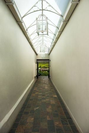 Passage with a skylight, leading toward a landscape - escape to nature concept Stock Photo