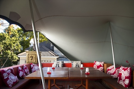 Lounge with tables of a club outside. Its underneath a big tent Stock Photo - 10715303