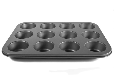 pan tropical: Grey muffin pan isolated on a white background Stock Photo
