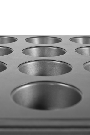 Grey muffin pan isolated on a white background photo