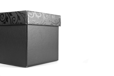 pack string: Black gift box with details on the top, isolated on a white background Stock Photo