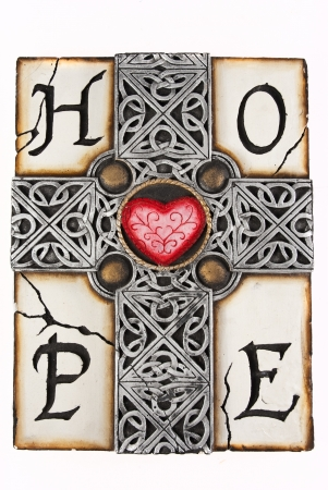 gothic church: Clay grey cross with intricate details with a red heart on the cross section, with the word HOPE spelt around it