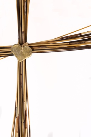 Cross made from brown grass Imagens