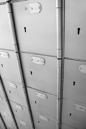 Grey postboxes with  numbers and keyholes Stock Photo