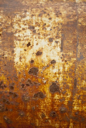 oxidized: Orange and brown rust texture shot of metal surface