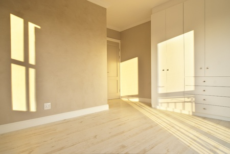 Empty bedroom inside a modern house photo