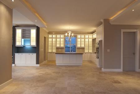 Empty kitchen inside a modern house photo