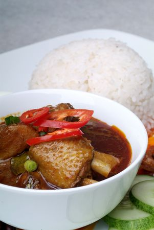Nasi lemak with chicken curry photo
