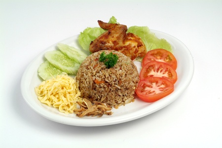 fried rice serve with chicken wing - malaysian food Stock Photo - 9267602