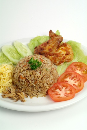fried rice serve with chicken wing - malaysian food Stock Photo - 9267558